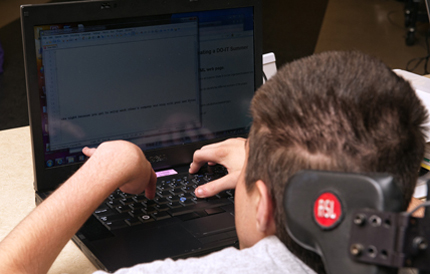 Person with disability using a laptop.