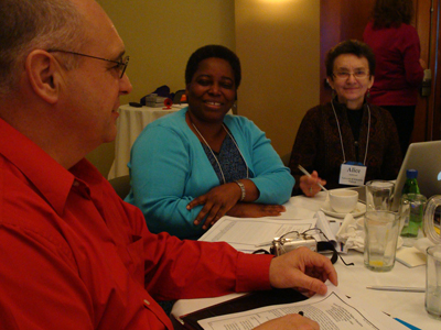 Three CBI participants discuss a topic