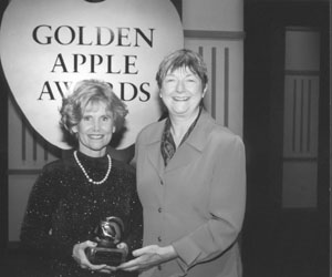 Picture of Sheryl with Terry Bergeson, Washington state Superintendent of Public Instruction at the Golden Apple Awards