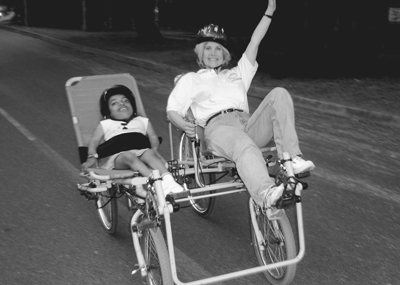 Picture of Sheryl and Jessie on an adapted bike.