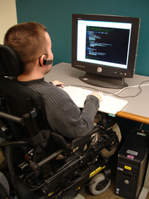 Picture of student in a wheelchair using a computer.