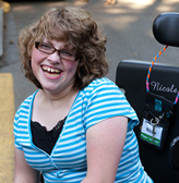 A student using a wheelchair enjoys college life
