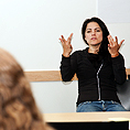 Image of a sign language interpreter in front of a class