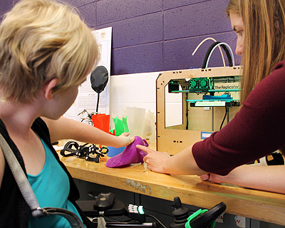 Image of an instructor demonstrating a prosthetics lab to a student