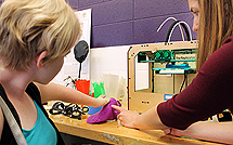 Image of an instructor demonstrating prosthetic modeling to a student