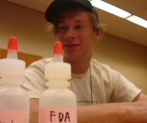 Photo of student working with chemicals.