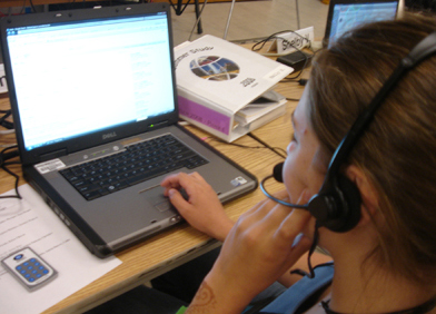 Photo of student using speech input on a laptop.