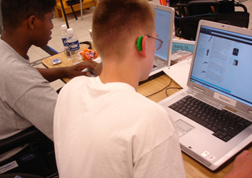 Photo of two students working on laptop computers.