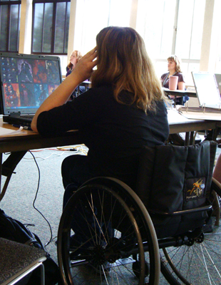 Photo of a student in wheelchair using a laptop.
