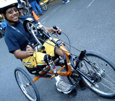 Photo of a student on an adaptive bike.