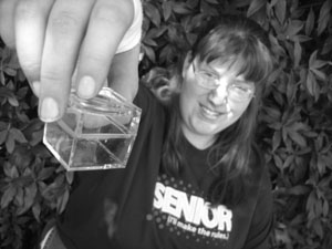 Photo of student holding out a sample box.