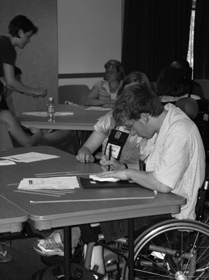 Photo of student in a wheelchair working on an engineering project