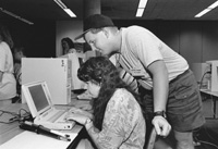 Photo of Anna and Lloyd in the computer lab.