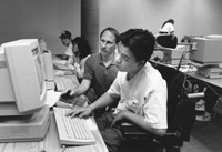 Photo of Nguyen and Tony in the computer lab