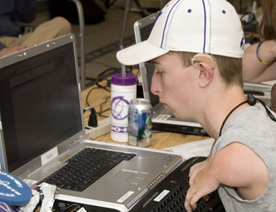 Photo of a student operates his computer using an alternative keyboard