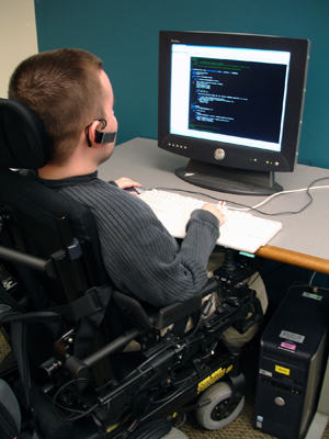 Photo of student in a wheelchair at a computer