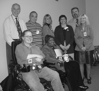 Photo of DO-IT student Marissa, front row far left, with her FAA colleagues.