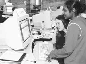 Photo of two DO-IT Scholars collaborate at a computer to problem solve.