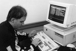 Photo of man at computer